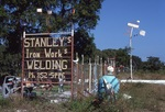 """Sign """"Stanley's Iron Works"""" with Sculptures by James Smith Pierce"""