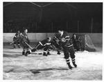 The 1953-54 UND Hockey Team in Action