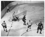 Gopher Goalie Tries to Stop the Puck
