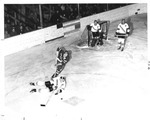 Bob Bartlett Forces a Gopher to Lose the Puck